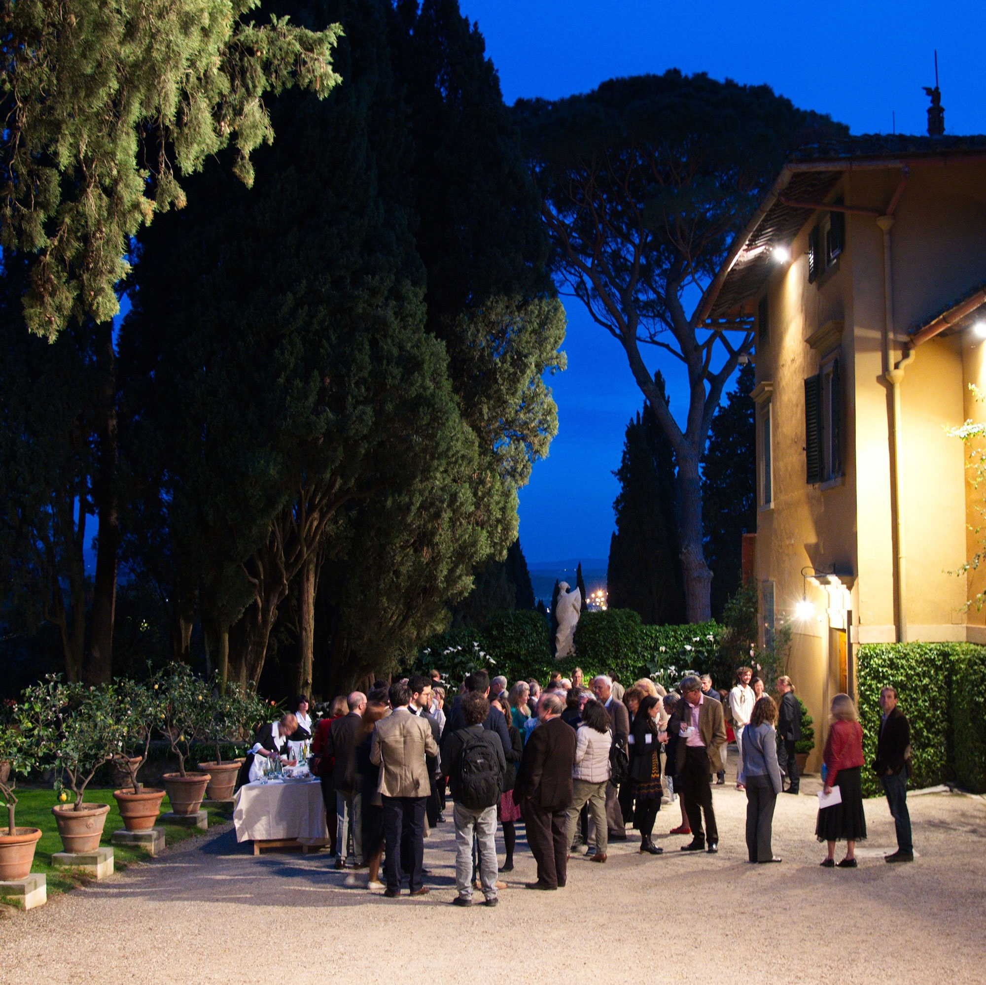 Guests on the south terrace at I Tatti